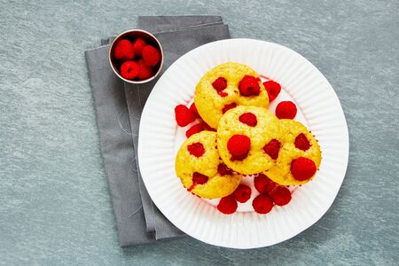 Raspberry muffins with fresh berries on plate flat-lay