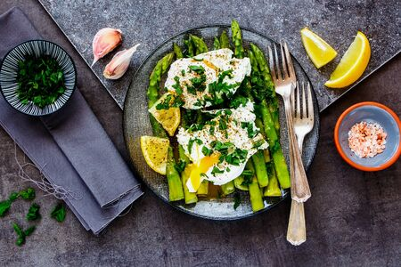 Plate with green aspargus and poached eggs top view Stock Photo