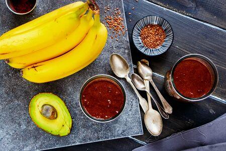Avocado, chocolate, banana smoothie jars top view