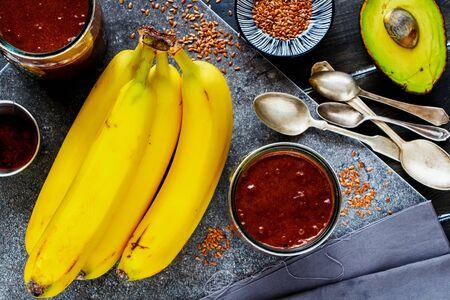Delicious avocado, chocolate, banana smoothie in jars close-up