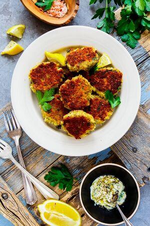 Vegetable pancakes, lemon and yogurt dressing in plate