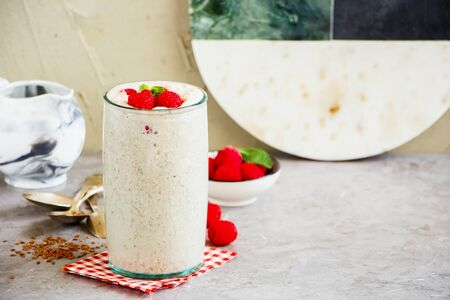 Raspberry yoghurt smoothie with fresh berries in glass jar Stock Photo