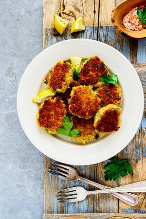 Homemade vegetable pancakes in plate flat lay Stock Photo