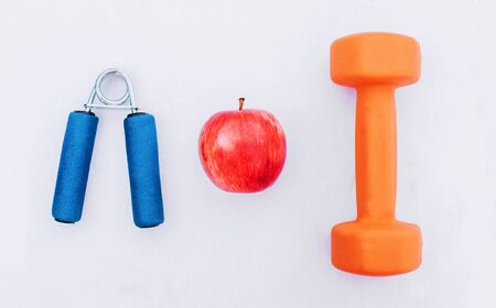 Sport equipment. Creative flat lay of sport and fitness equipments on white background with copy space. Top view.