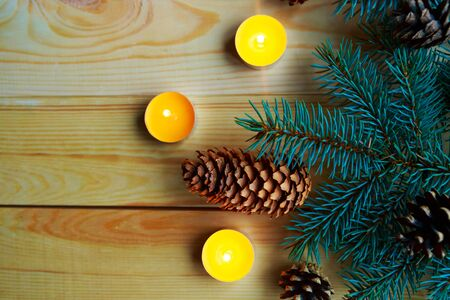 Christmas composition with christmas tree and candles on wooden background, flat lay, top view, copy space