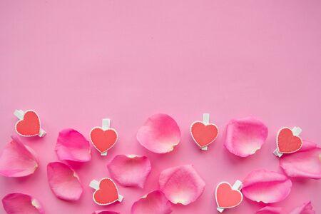 pink rose petals on pink background.