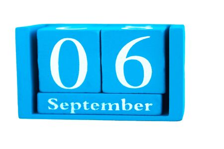 Wooden calendar September 6, isolated on white