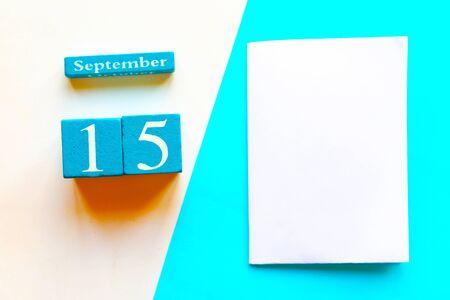 September 15. Wooden handmade calendar and white mockup blank on geometric white and blue background Stock Photo