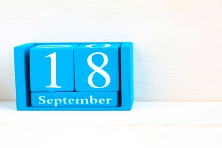 September 18, wooden background. Handmade wooden cube calendar with date month and day Archivio Fotografico