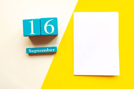 September 16, empty yellow and white geometric background and white mockup blank. Wooden handmade calendar 스톡 콘텐츠