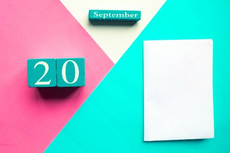September 20. Wooden handmade calendar and white mockup blank on geometric white, pink and blue background