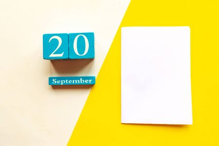 September 21, empty yellow and white geometric background and white mockup blank. Wooden handmade calendar