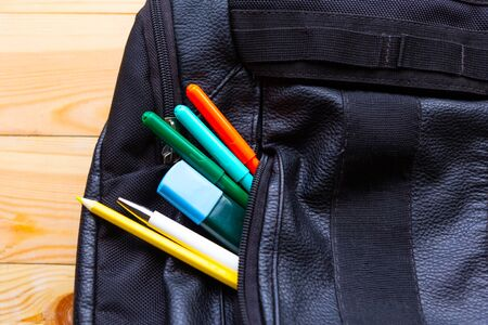 School bag and pencils on wooden table. Back to school concept 스톡 콘텐츠