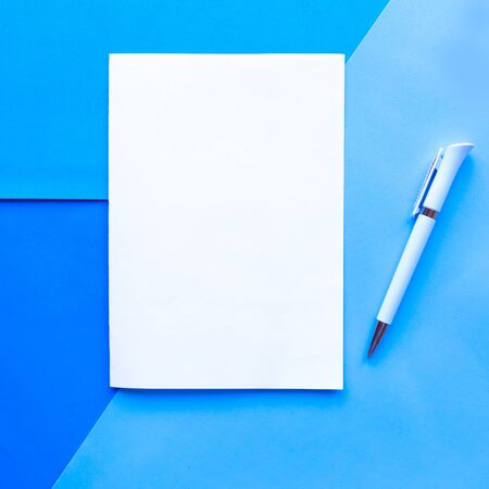 White mockup blank on geometric blue background. Copy space for the text. Design concept