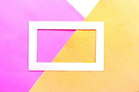 White photo frame on geometric pastel background. Copy space for the text. Design concept 스톡 콘텐츠