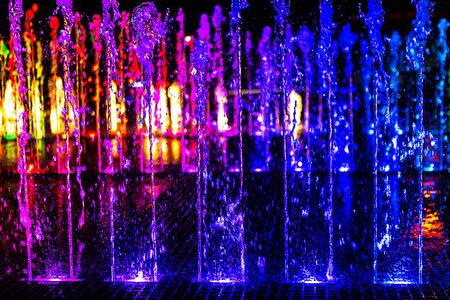 Bright and colorful fountain at night street