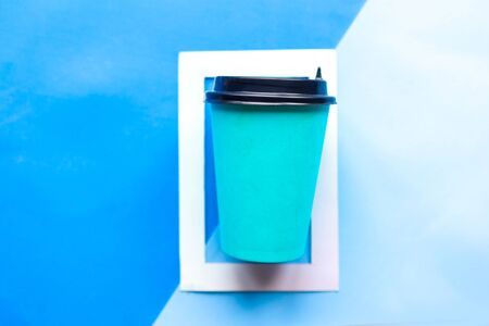 Take away coffee cup in white photo frame. Minimal concept. Geometric background