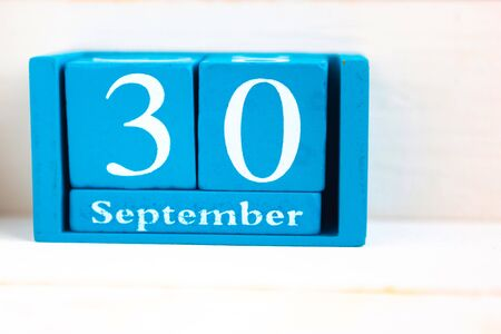 September 30, wooden background. Handmade wooden cube calendar with date month and day Zdjęcie Seryjne