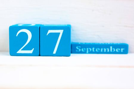 September 27, wooden background. Handmade wooden cube calendar with date month and day Zdjęcie Seryjne