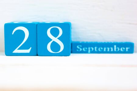 September 28, wooden background. Handmade wooden cube calendar with date month and day Zdjęcie Seryjne