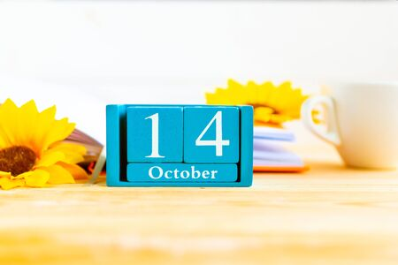 October 14 on the wooden calendar.The fourteen day of the autumn month, a calendar for the workplace. Autumn.