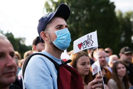 Minks / Belarus - 30 July 2020: portrait of young man in protective mask in the park during the presidential election campaign 2020 in Belarus. Elections in Belarus 2020 Editoriali