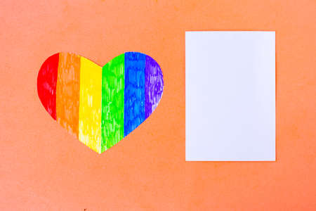 Heart in lgbtq colors and white mockup blank on pastel pink background, top view, copy space Banque d'images