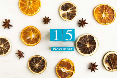 November 15. Blue cube calendar with month and date on wooden background. Stock Photo
