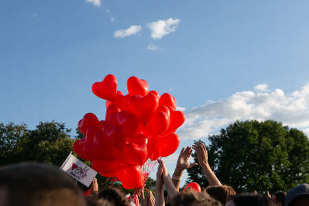 Minsk / Belarus - July 30, 2020: Red balloons in heart shape in the air at opposition rally in Minsk on July 30, 2020. Belarusian politic opposition. Presidential Elections in Belarus 2020