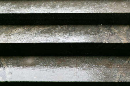 wet steps in the underpass, rain background