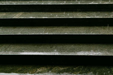 wet steps in the underpass, rain background Stock Photo