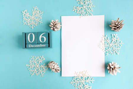 December 6. Blue cube calendar with month and date and white mockup blank on blue background. Banco de Imagens
