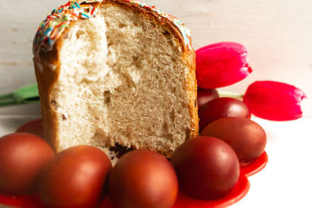 Traditional Easter cake and painted eggs on the table Stock Photo