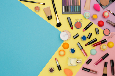 Make up bag with cosmetics isolated on color background