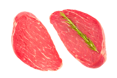 Two slices of fresh raw beef meat for steaks. Top view, isolated on white background