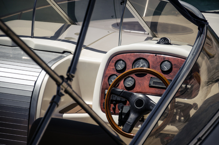 Wooden steering wheel ship on yacht; workplace of the captain yacht.