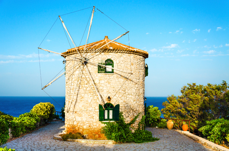 Traditional Greece old windmill at summer day.