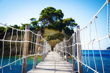 Wooden bridge to Cameo island. Zakynthos, Greece. Summer time vacation.