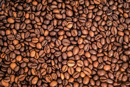 Roasted brown coffee beans background.