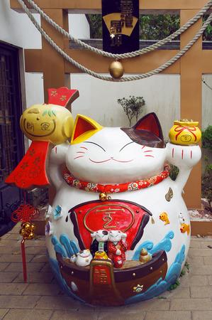 maneki neko: Lucky cat  Maneki neko  statue Editorial