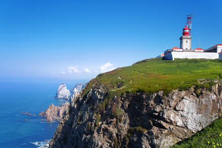 Cabo da Roca Cape Roca is a cape which forms the westernmost point of both mainland Portugal mainland Europe and the Eurasian land mass. photo