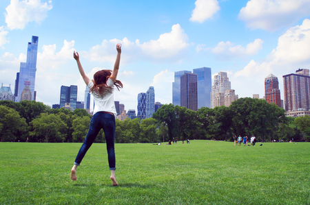 futuristic city: Girl jump in the Central Park
