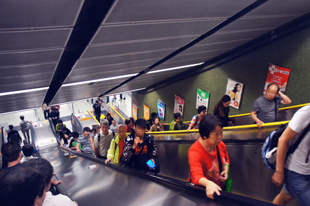 People move up escalator at the Diamond Hill station of Mass Transit Railway in the Hong Kong