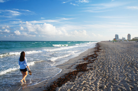 sunny south: Girl walk at the sunny South Beach of Miami, United States Stock Photo