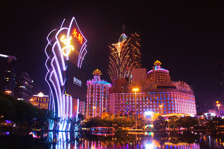 Macau, Macau S.A.R. - November 23, 2015: The night facades of Grand Lisboa Macau casino resort and Wynn,  luxury hotels in Macau Peninsula.