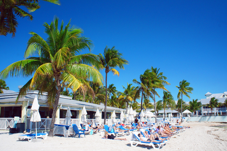 sunny south: Key West, United States - February 6, 2016: People relax at the sunny South Beach of Key West near Atlantic Ocean.