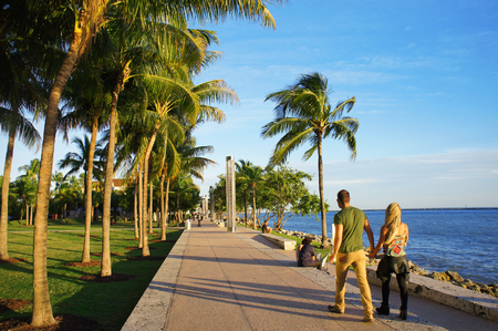 sunny south: Miami Beach, United States - February 8, 2016: People walk and relax at the sunny South Point Park of Miami near Atlantic Ocean. Editorial