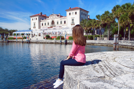 vizcaya: Miami, United States - February 8, 2016: Tourist girl look at the Villa Vizcaya of Biscayne Bay in Miami.