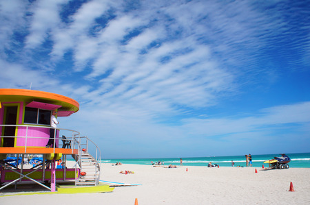 sunny south: Miami Beach, United States - February 11, 2016: People walk and relax at the sunny South Beach of Miami near Atlantic Ocean.