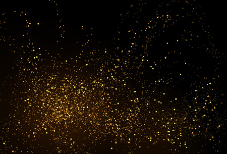 Gold glitter powder splash background. Golden scattered dust. Magic mist glowing. Stylish fashion black backdrop.